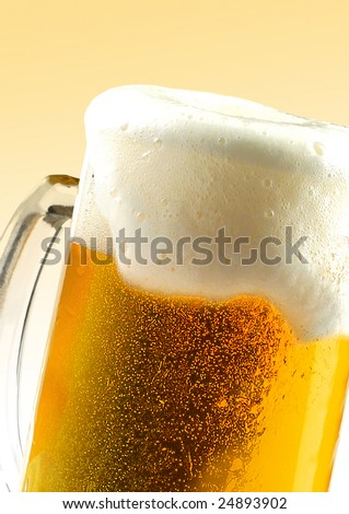 Golden  beer  with  bubble  and foam - stock photo