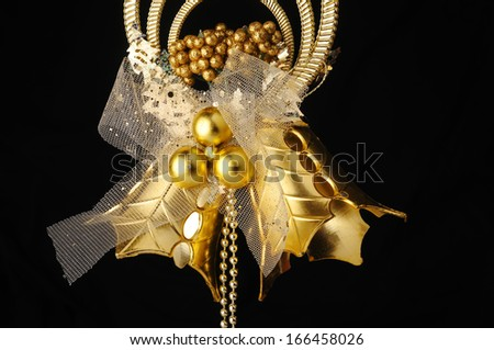 golden bells bow. isolated on blck - stock photo