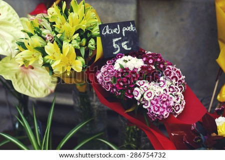 Golden Bells Plant and Cloves Turkish, fresh cut flowers for any occasion for women, cheap flowers in a flower shop - stock photo