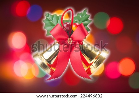 golden bells with a red bow - stock photo