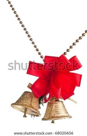 Golden bells with red bow on a beads chain isolated - stock photo