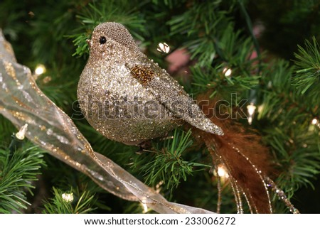 Golden bird ornament - stock photo