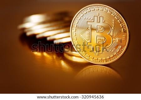 Golden Bitcoins on a gold background .Photo (new virtual money ) - stock photo