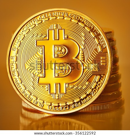 Golden Bitcoins on a gold background .Photo (new virtual money )  - stock photo