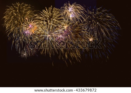 Golden, blue and purple fireworks over night sky. 4th of July, Independence Day celebration fireworks. Canada Day, New Year holidays salute.  - stock photo