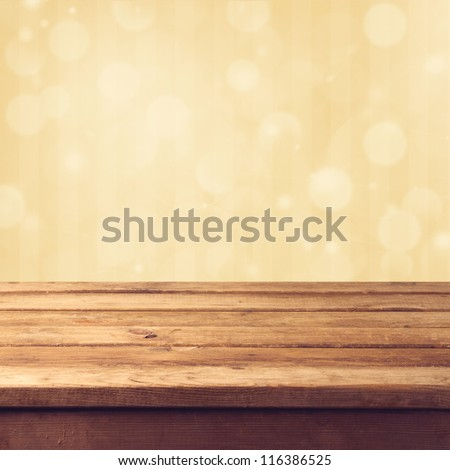 Golden bokeh background with wooden table