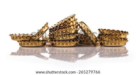 golden bottle caps on table - stock photo