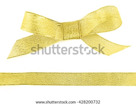 Golden bow and ribbon isolated on white - stock photo