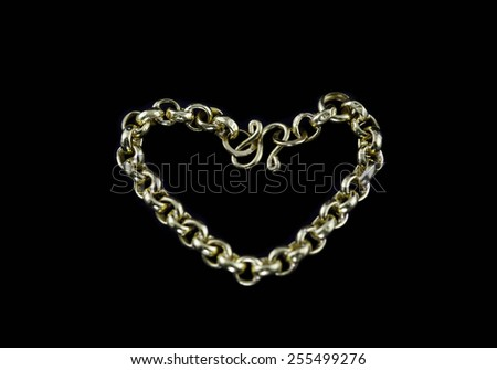 Golden bracelet isolated black background. - stock photo