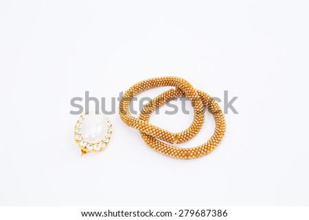 Golden bracelet with diamonds on white background - stock photo