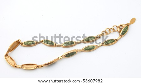 Golden bracelet with jade inlets