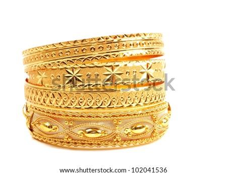 Golden bracelets , isolated on white background - stock photo