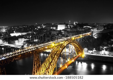 Golden Bridge on a monochromatic background, night view of the  Dom Luiz bridge captured on a slow shutter, Porto , Portugal - stock photo