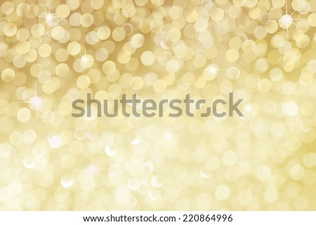 golden bright sparkles with stars over blurred illuminated background - stock photo