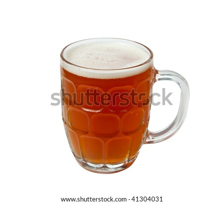 Golden brown beer in an English style pint mug with foamy head - stock photo
