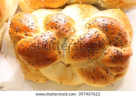 golden brown home made challah egg bread - stock photo