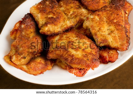 Golden brown Italian style chicken cutlets - stock photo