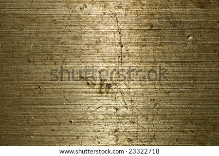 Golden Brushed metal background with dings and dents - stock photo