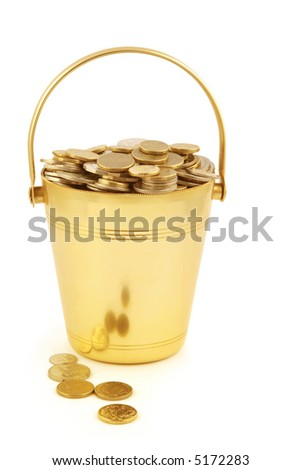 Golden bucket of money. - stock photo