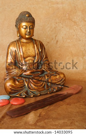 golden Buddha figure and incense  stick - stock photo