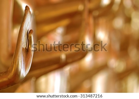 Golden Buddha hand backgrounds use for pardon and forgive - stock photo
