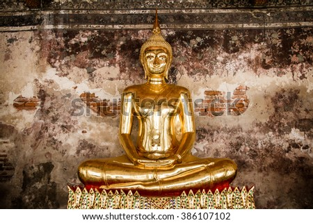 Golden Buddha in a temple in Thailand.