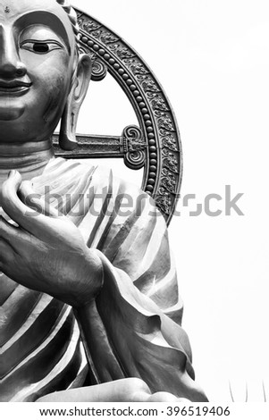 Golden Buddha on white background.