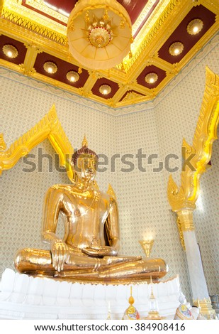 Golden Buddha, Solid Gold. Made in the 13th-14th centuries, on public display at Wat Traimit, Bngkok, Thailand - stock photo
