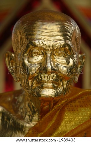 Golden Buddha statue. - stock photo