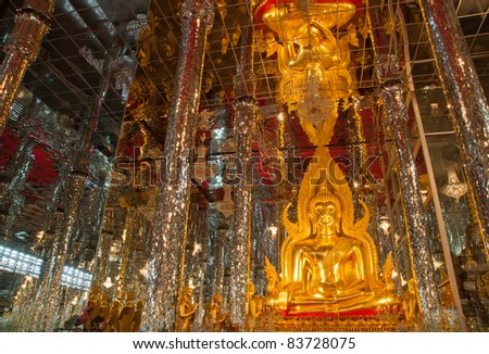 Golden Buddha statue at Cathedral glass, Temple in Thailand - stock photo