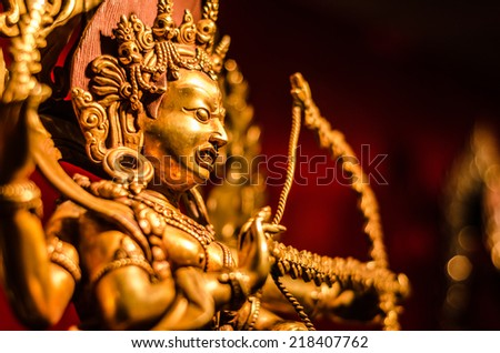Golden Buddha statue from Tibet - stock photo