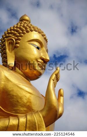 Golden Buddha statue in blue sky,Hua Hin Thailand. - stock photo
