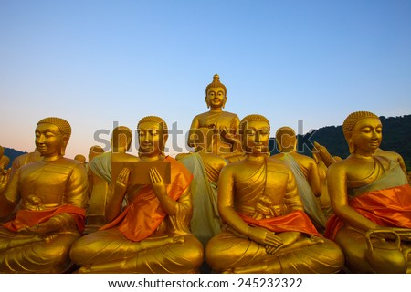 golden buddha statue in temple with beautiful morning light against blue sky use for multipurpose in religion theme  - stock photo