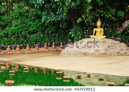 Golden Buddha statue in Wat Phan-tao temple in chiang-mai, Thailand - stock photo