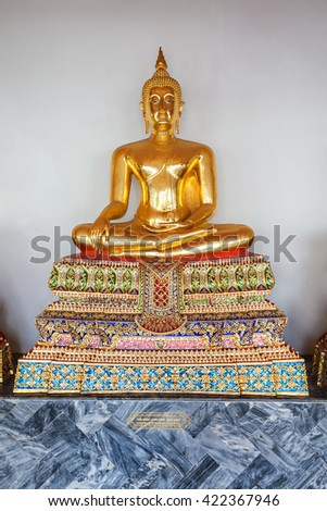 Golden Buddha statue in Wat Pho Temple - Buddhist temple complex in Bangkok, Thailand - stock photo