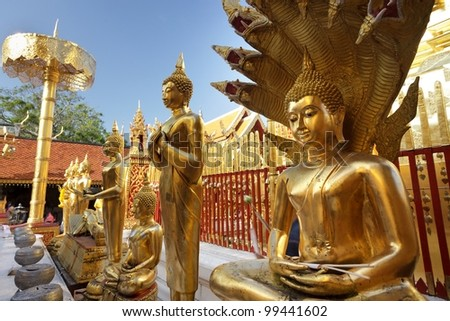 golden buddha statues in doi suthep temple, chiang mai, thailand