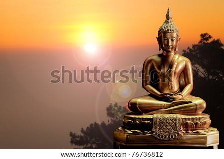 Golden buddha with sunlight in the morning - stock photo
