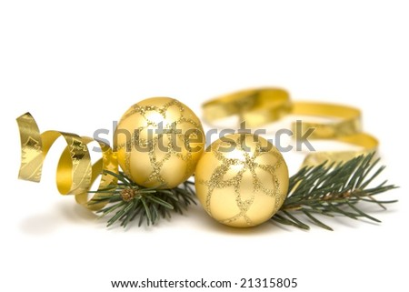 Golden  bulbs and spruce twigs on a white