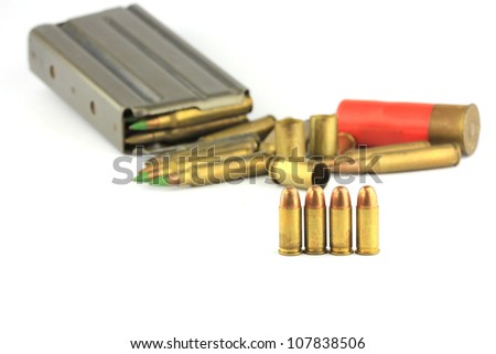 Golden bullets isolated on white - stock photo