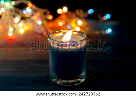 Golden burning candles bokeh blured background  - stock photo