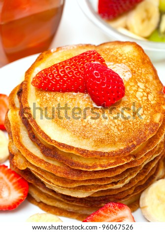 golden buttermilk pancakes with strawberry and banana - stock photo