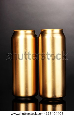 golden cans on grey background