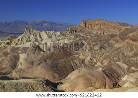 Golden Canyon and Gower Gulch Loop trail view of badlands at Zabriskie point in national park Death Valley, USA
