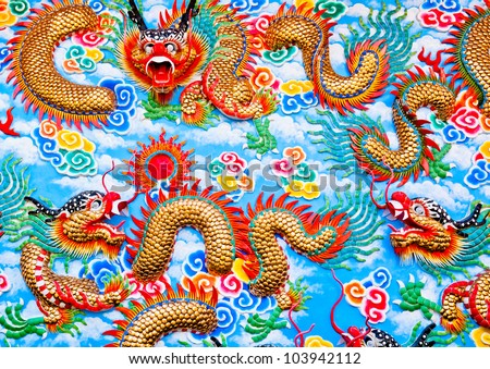 Golden chinese  dragon at the wall of temple, Thailand