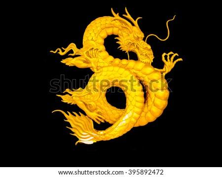 golden Chinese dragon on black background art - stock photo