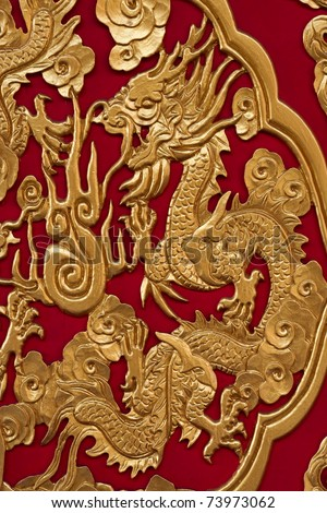 Golden Chinese Dragon on Red Background - stock photo