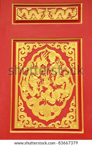 Golden Chinese Dragon on Red Background at chinese temple in Thailand - stock photo