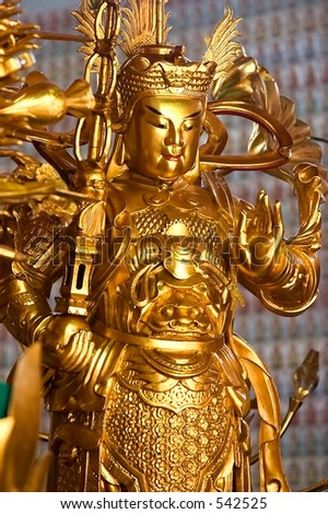 Golden Chinese God Statue - stock photo