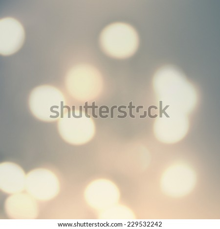Golden Christmas background. Festive xmas abstract background with bokeh defocused lights and stars. Boke twinkling Lights Festive holiday party background with blurry special magic effect.  - stock photo