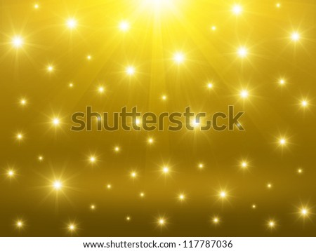 Golden christmas background with glowing sparkles effect - stock photo